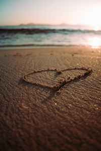 heart drawing on a sandy beach
