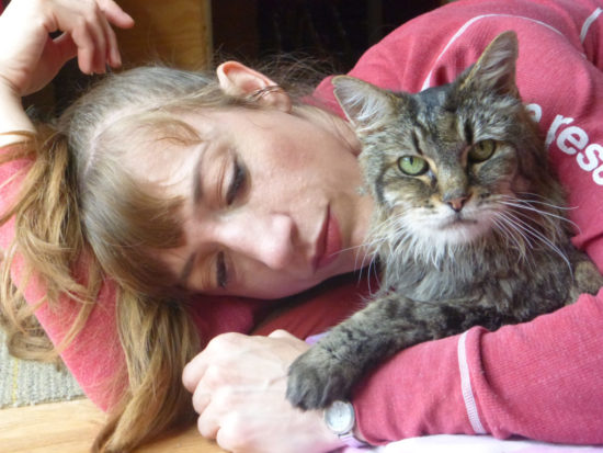woman-hugging-cat