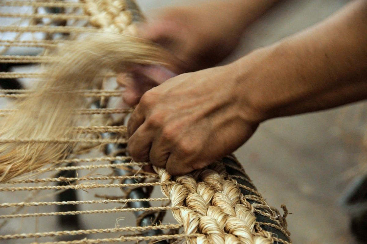 Abaca rug being hand braided