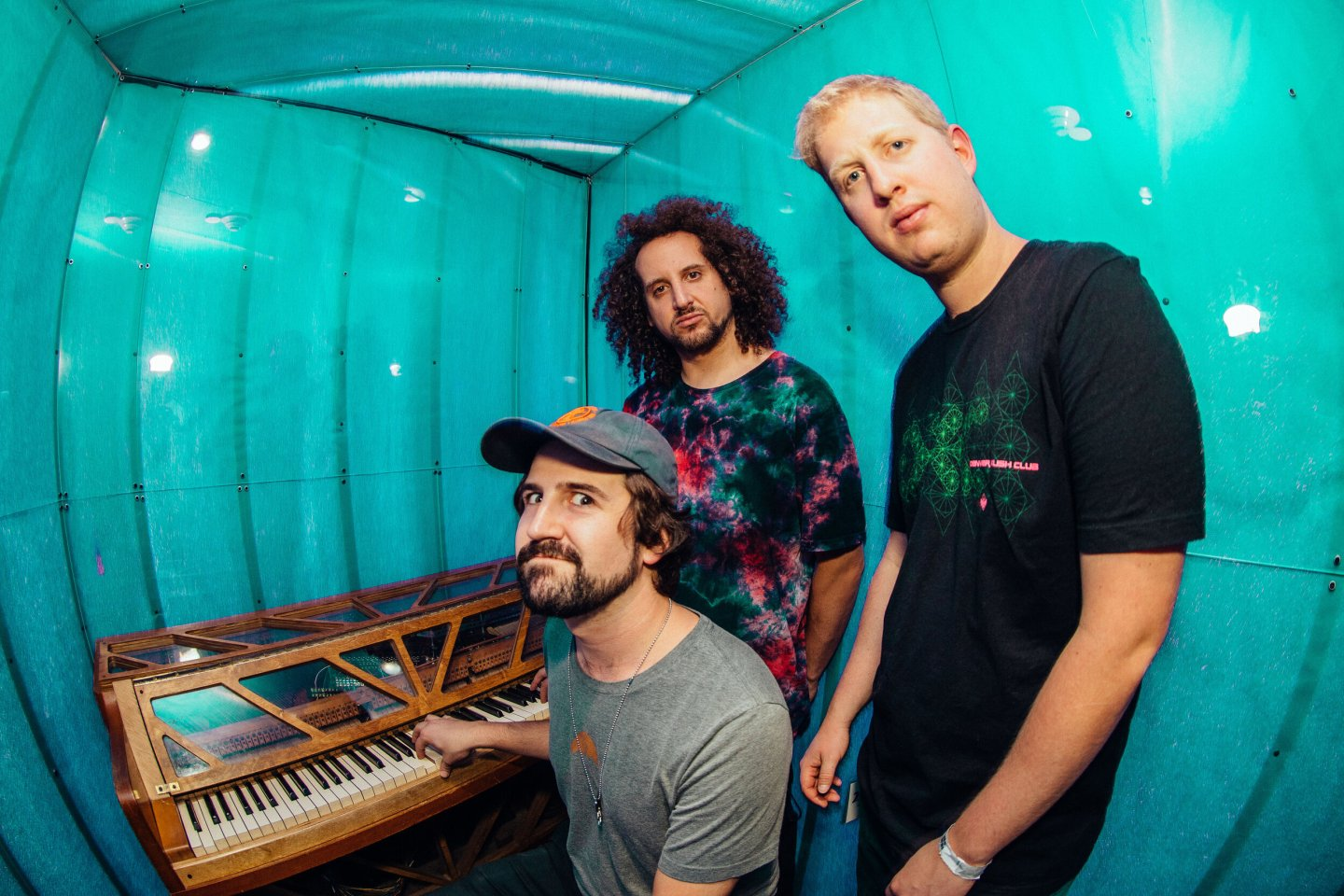 Jamtronica three piece band SunSquabi pose inside Meow Wolf while on tour in Santa Fe
