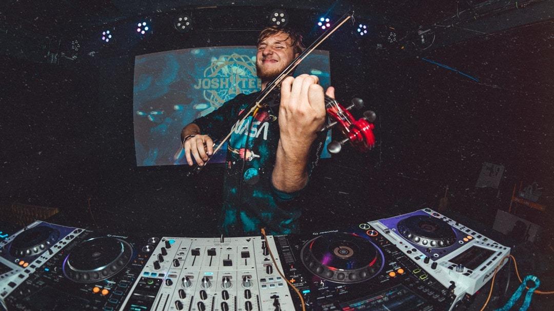 Josh Teed plays violin live while DJing