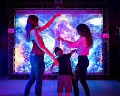 family dancing at android jones' samskara immersive art exhibit