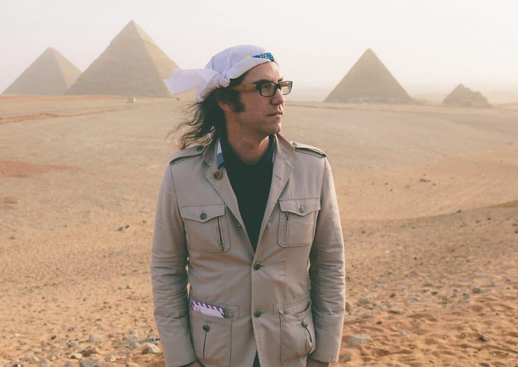electronic producer Random Rab stands in front of Giza Pyramids