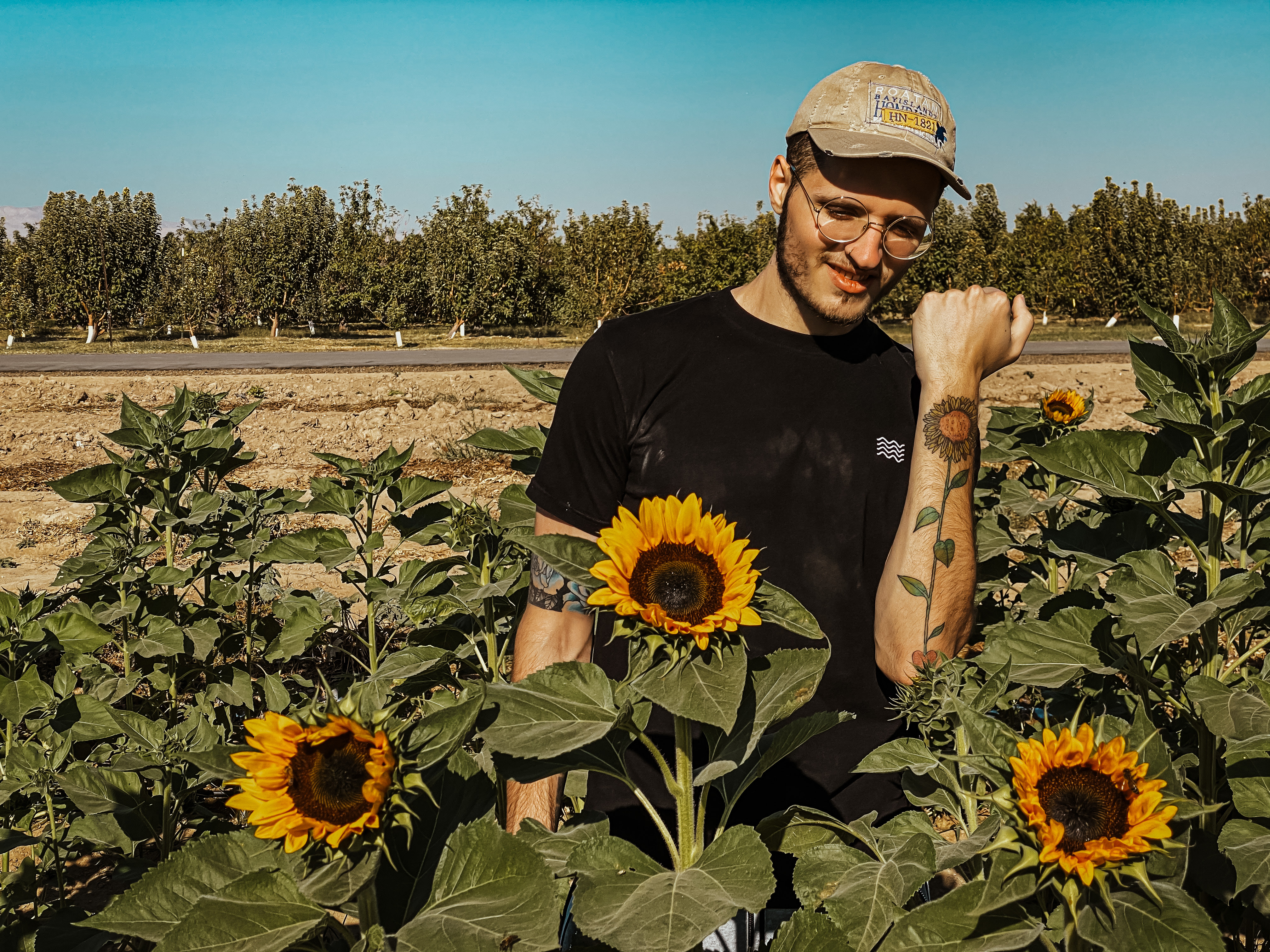 Sofasound edm producer press pic sunflowers in field