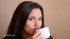 Woman-Sip-Coffee-Tea-Cup