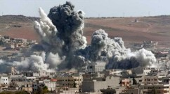 Thick smoke from an airstrike by the US-led coalition rises in Kobani, Syria, as seen from a hilltop on the outskirts of Suruc, at the Turkey-Syria border, Wednesday, Oct. 22, 2014. Kobani, also known as Ayn Arab, and its surrounding areas, has been under assault by extremists of the Islamic State group since mid-September and is being defended by Kurdish fighters. (Photo: Lefteris Pitarakis/AP)