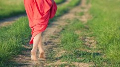 walking barefoot woman