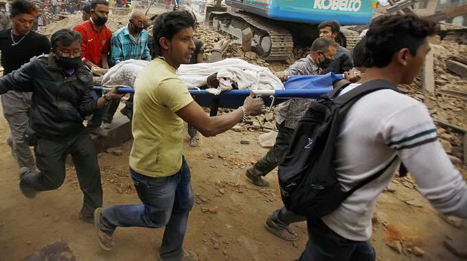 Nepal-Earthquake-aftermath-people-carrying-stretcher-running