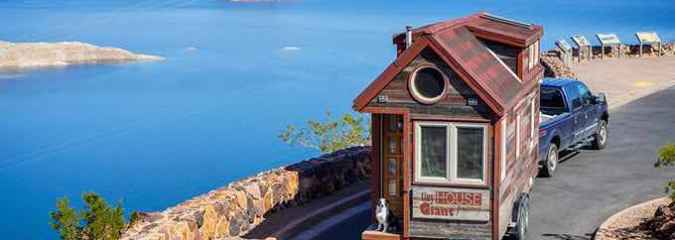 Couple Quits Their Day Jobs & Takes Their Tiny Home On Tour