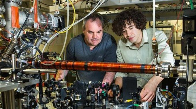 Australian National University Associate Professor Andrew Truscott (L) with Ph.D. student Roman Khakimov. Credit: Stuart Hay, ANU