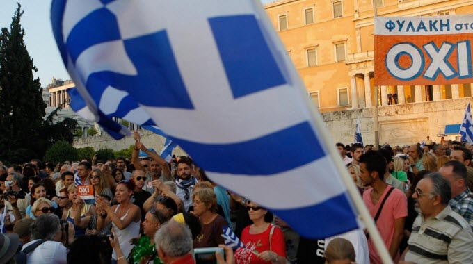 Supporters of the NO vote in the upcoming referendum hold a banner with colors of the Greek flag reading ''NO, OXI'' during a rally at Syntagma on Monday. (Photo: Aristidis Vafeiadakis/ZUMA Press/Corbis)