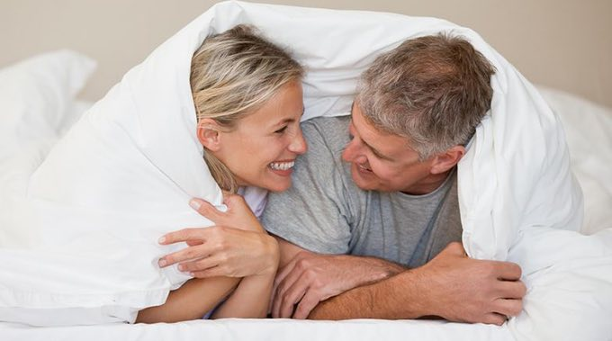 couple in bed playing