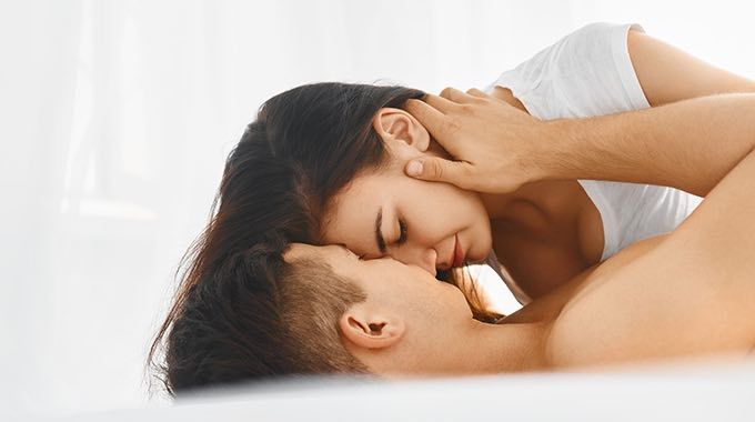 man and woman lovers in bed