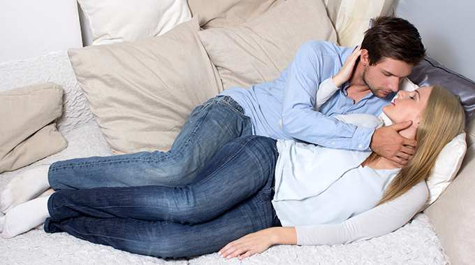 couple on couch kissing