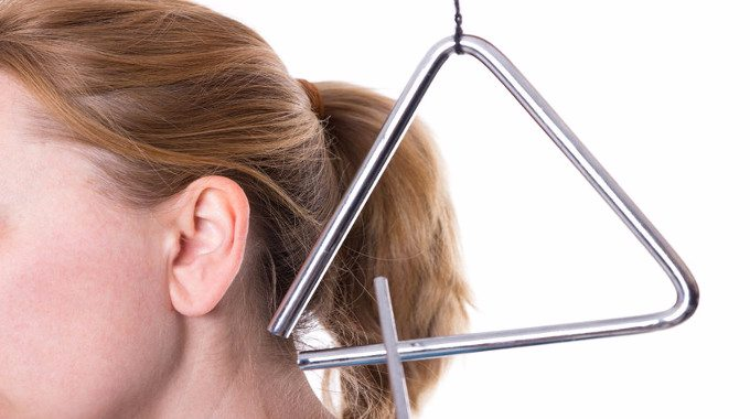 A triangle in the vicinity of a female ear-compressed