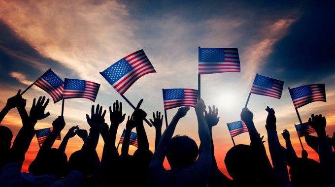 Group of People Waving American Flags-compressed