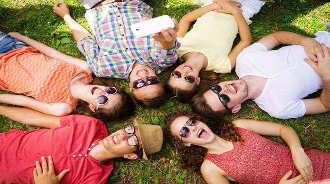 Group of young people having fun in park-compressed
