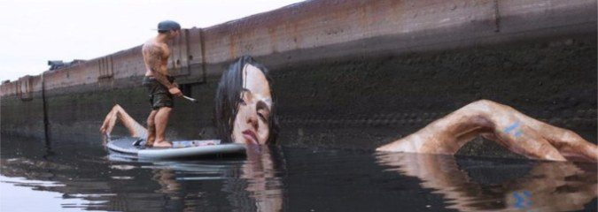 This Artist Paints Stunning Seaside Murals While Balancing On A Paddleboard