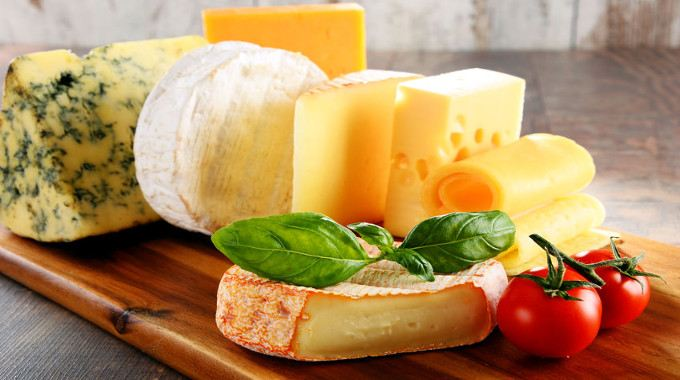 different-sorts-of-cheese-isolated-on-kitchen-table-compressed