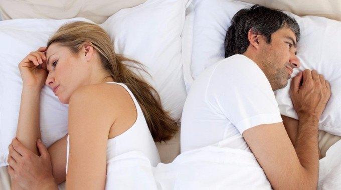 upset-couple-sleeping-separately-compressed