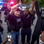 Police Officers Join Protesters Marching Against Brutality In Some Cities