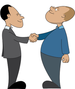 histoire d'entrepreneur_deux hommes de 40 ans se serrent la main.