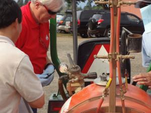 Checking pressure gauge during 2014 sprayer calibration workshop
