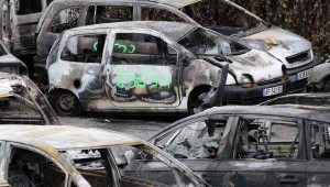 Notice the Arabic Graffiti painted on one of the burned cars.