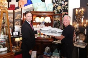 Tim Albrecht (Right), owner and operator of Consider it Done Boutique in downtown Bethesda, Md.