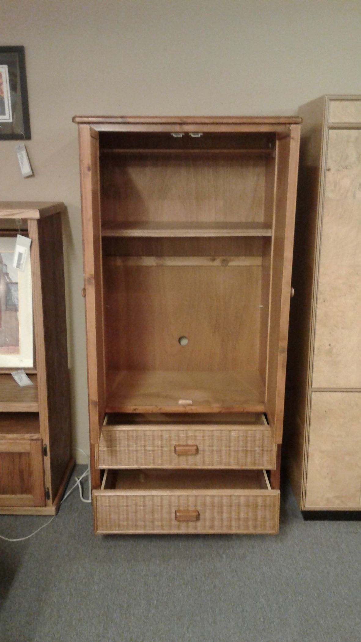 WICKER WOOD WARDROBEARMOIRE  Delmarva Furniture Consignment