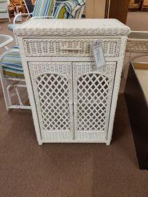 white wicker storage cabinet