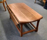 OVAL DROP LEAF COFFEE TABLE | Delmarva Furniture Consignment