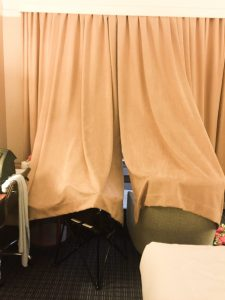 Makeshift room out of curtains in hotel