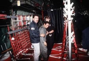 Gen. Manuel Noriega is escorted onto a U.S. Air Force aircraft by agents from the U.S. Drug Enforcement Agency after his arrest on Jan. 1, 1990. (U.S. military photo)