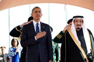 President Obama and King Salman Arabia stand at attention during the U.S. national anthem as the First Lady stands in the background with other officials on Jan. 27, 2015, at the start of Obama's State Visit to Saudi Arabia. (Official White House Photo by Pete Souza). (Official White House Photo by Pete Souza)