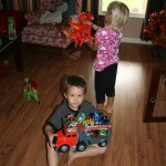 Playing with Fisher-Price Rev 'n Go Stunt Hauler