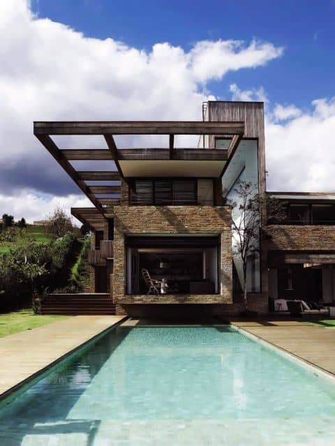 22 ideias para fachadas de casas r sticas com tijolos for Casa moderna rustica