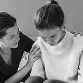 A parent comforting a teenager