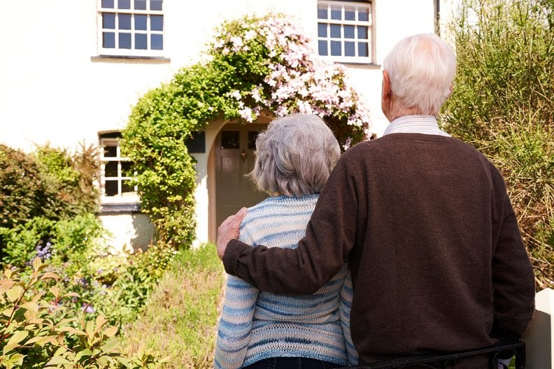 Senior couple looking at their nice house