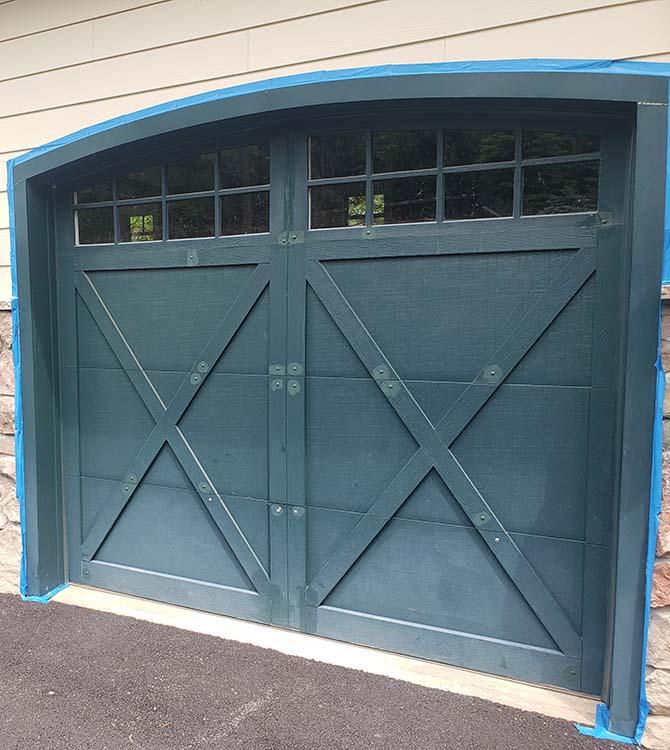 Before photo of a freshly painted garage door