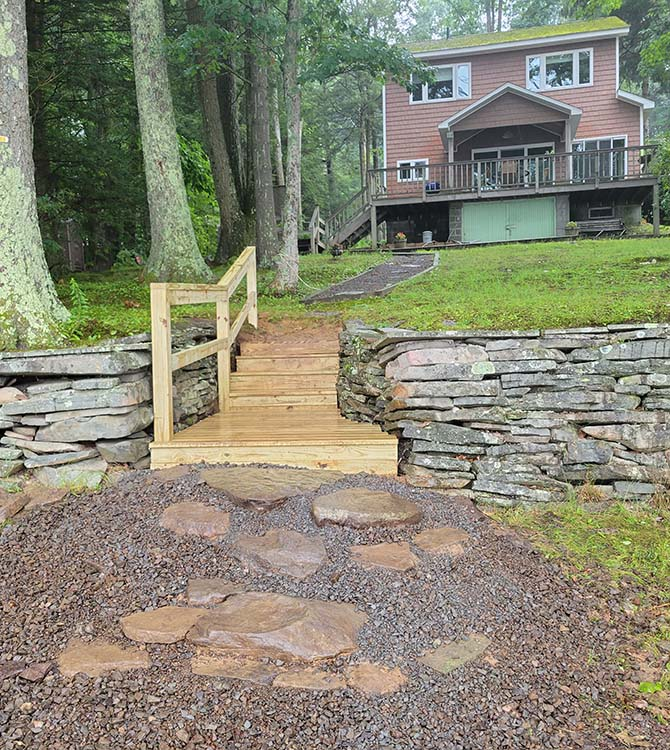 After photo of wooden stairs and stone pathway