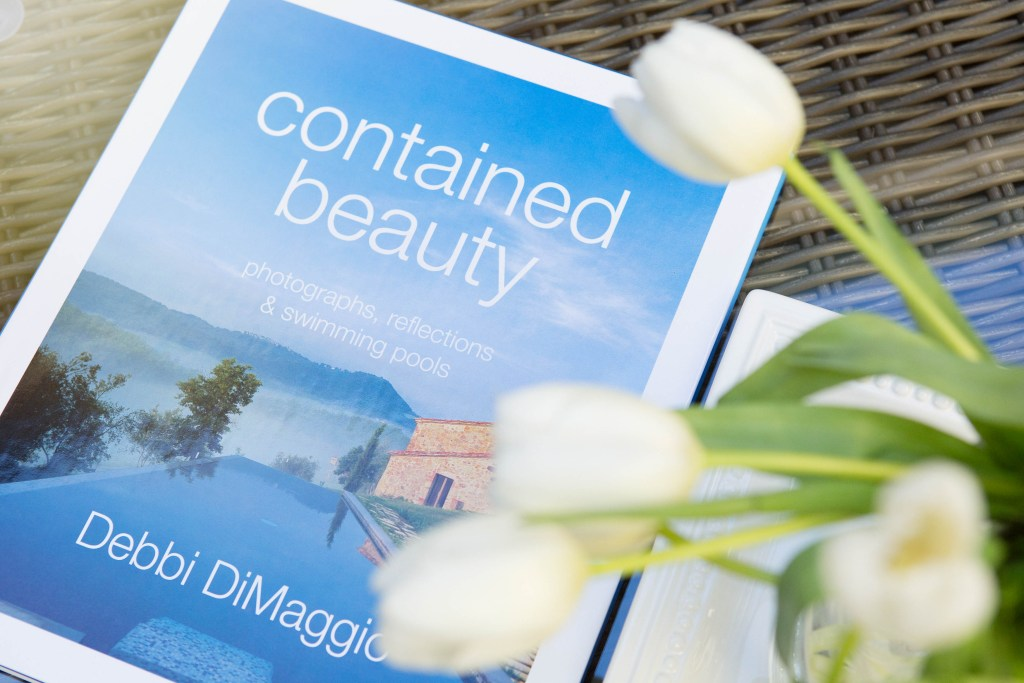 "Travel the world through the pages of ""contained beauty, photographs, reflections and swimming pools."""