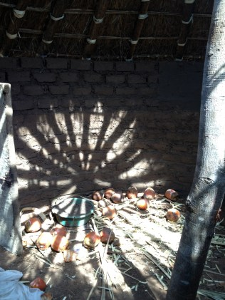 This unfinished hut had a beautiful light and shadow play on the floor, through the unfinished roof.