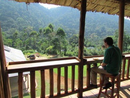 A PeaceCorps Volunteer enjoys tea, bread and a view of the Impenetrable forest.