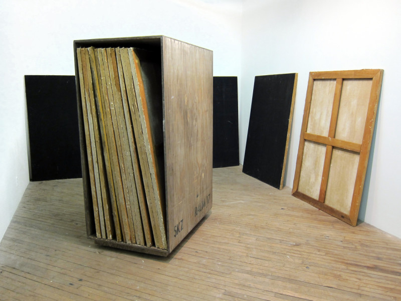 1 SKZ Painting Storage Cabinet and 2A0 Size Black Monochrome (2011), painted plywood cabinet, oil on linen paintings, 72 x 48 x 36 inches. Image courtesy of the artist. Photo: Dan Levenson.