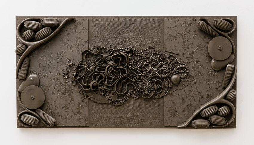 Isabelle Cornaro, Orgon Door II (brown) (2014). Tinted elastomer and MDF. 17.3 x 33.8 x 2.3 inches.  Image courtesy of the artist and Hannah Hoffman Gallery.