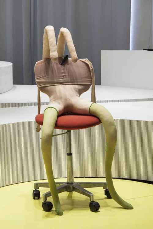 Sarah Lucas, Bunny gets snookered #3, 1997, Red office chair, green stockings (1 pair), tan tights (3 pairs), clamp, kapok, wire, Approx. 119,5 x 58 x 61 cm, Courtesy Thyssen-Bornemisza Art Contemporary, Exhibition view, THEM, Schinkel Pavillon, 2015, Photo: Timo Ohler