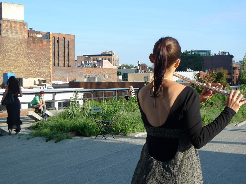 """Conceived by RU artist Ana Prvacki (Serbia), """"Wandering Band"""" was a series of performances in June 2010 where vocalists and musicians armed with portable wind, string, and brass instruments strolled along The High Line performing their daily scales, tonal, and finger exercises."""