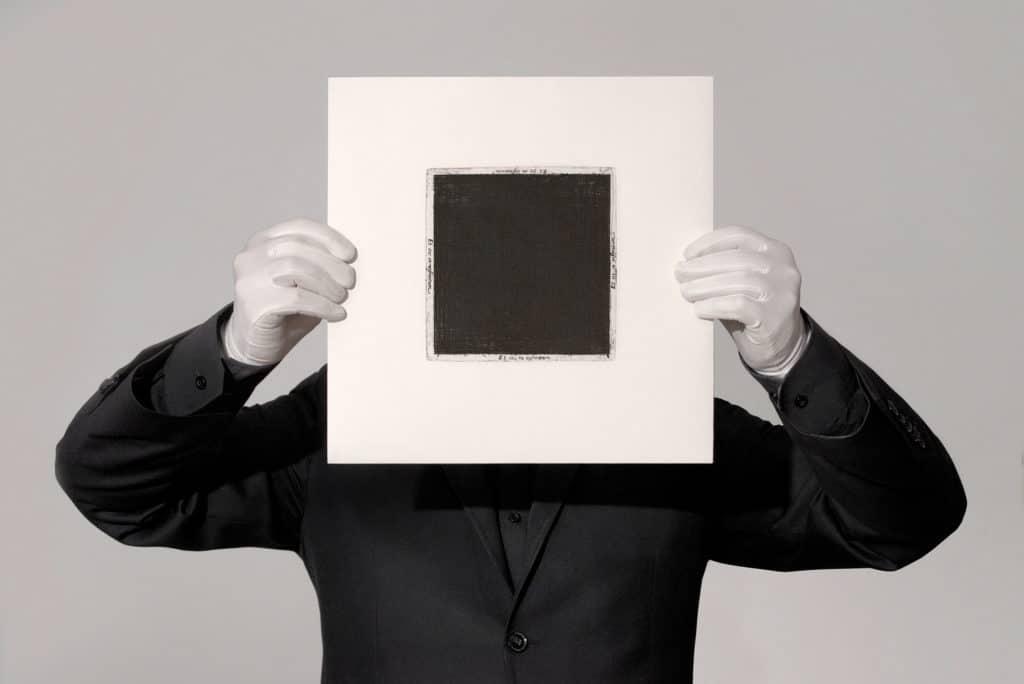 """Jakub Woynarowski, portrait with """"Fiat Lux"""" vinyl record by Quadratum Nigrum collective (Jakub Woynarowski, Jakub Skoczek, Mateusz Okoński), 2015, photo: Justyna Gryglewicz"""