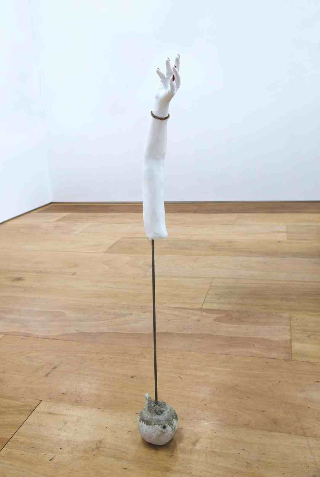 Anna Perach, Hand,155×29cm, Plaster, metal pole, cement, nail polish, porcelain, baby teeth casting, 2017